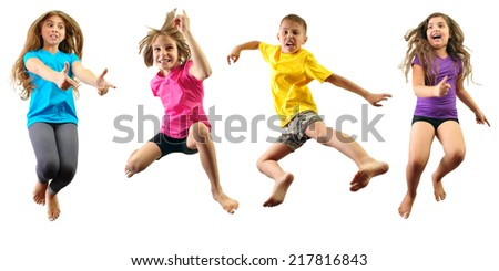 Group of happy children jumping and having fun isolated over white. Childhood, happiness, active lifestyle concept - stock photo