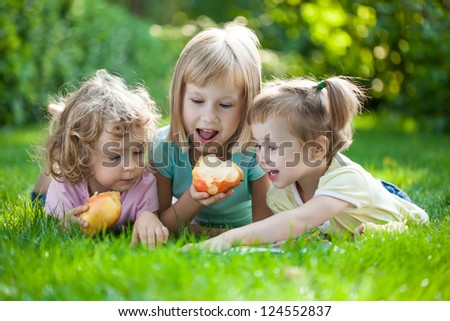 Group of happy children playing outdoors in spring park - stock photo