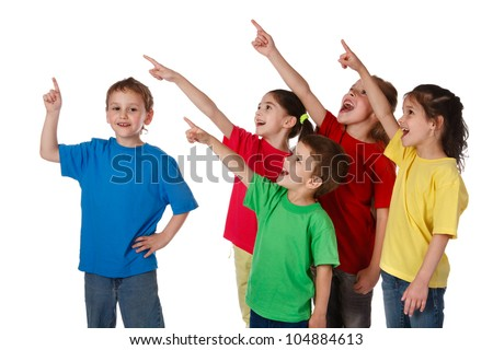 Group of happy children with pointing up sign, isolated on white - stock photo