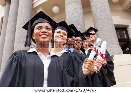 group of happy college graduates on graduation day - stock photo