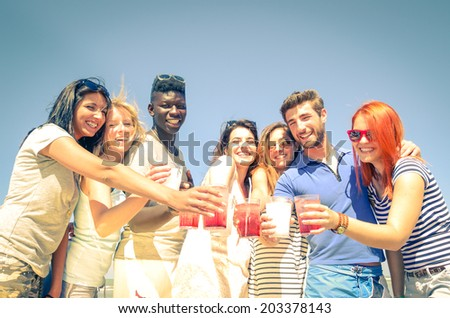 Group of happy friends drinking cocktails - stock photo