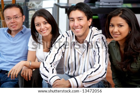 group of happy friends smiling at their home - stock photo