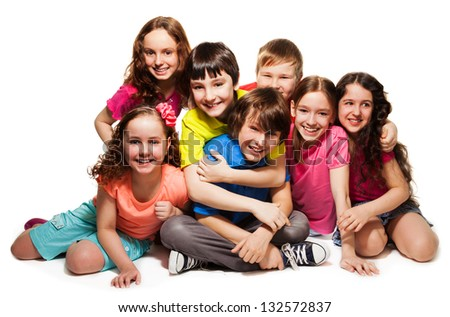 Group of happy hugging kids, laughing and smiling together in big group - stock photo