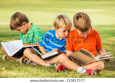 Group of Happy Kids Reading Books Outside, Friendship and Learning Concept - stock photo