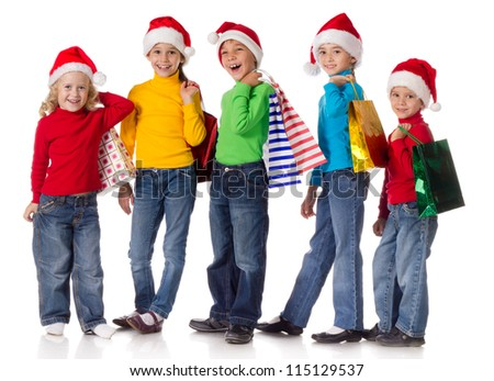 Group of happy kids with christmas gifts, isolated on white - stock photo