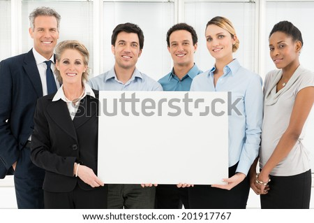 Group Of Happy Multi Ethnic Businesspeople Holding Blank Placard - stock photo