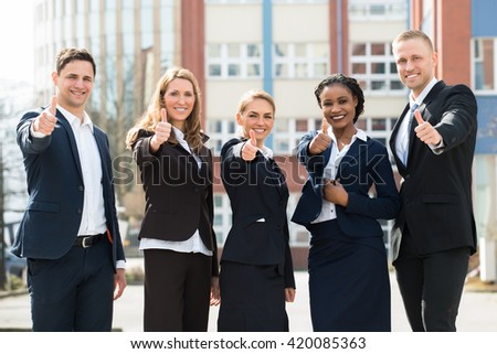 Group Of Happy Multi-racial Businesspeople Showing Thumb Ups  - stock photo