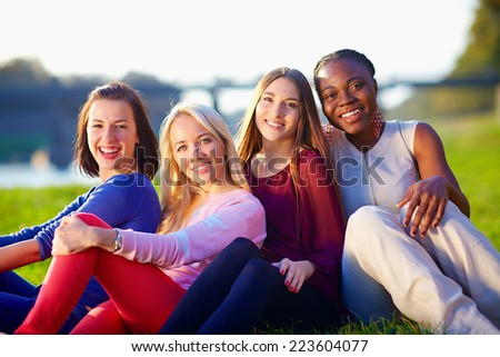group of happy multiracial friends, outdoors - stock photo