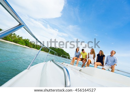 Group of happy people relaxing on the yacht. Luxury life.  Focus on people.  - stock photo