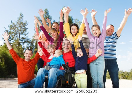 Group of Happy People smiling with hands up. - stock photo