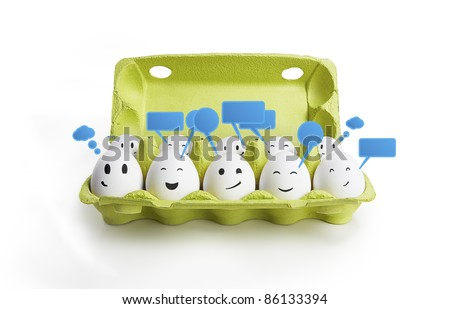 Group of happy smiling eggs with social chat sign and speech bubbles.  Ten white eggs in a carton box representing a social network. Isolated on a white background - stock photo