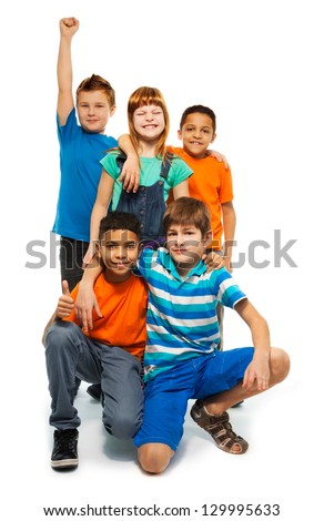 Group of happy smiling kids standing together - boys and girls black and Caucasian - stock photo