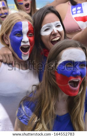 Group of happy soccer fans commemorating victory yelling. - stock photo
