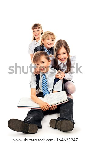 Group of happy students standing together. Education. Isolated over white background. - stock photo