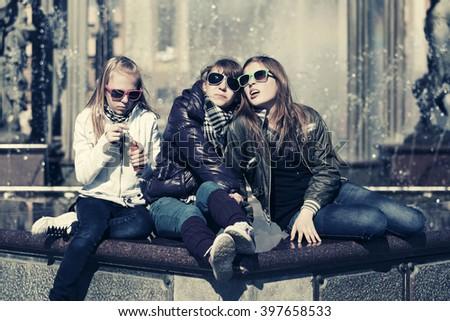 Group of happy teen girls on city street - stock photo