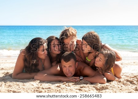 Group of happy teens at the beach - stock photo