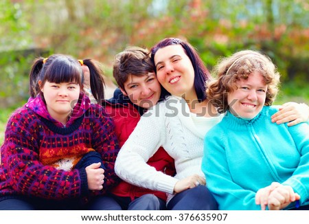group of happy women with disability having fun in spring park - stock photo