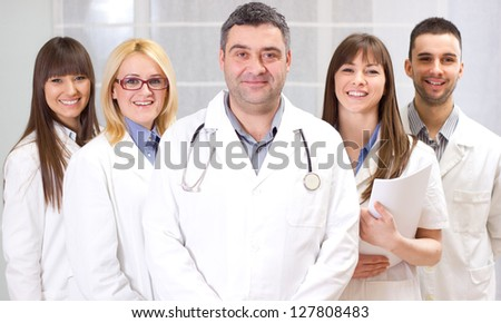 Group of happy young doctors standing together. - stock photo