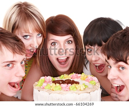Group of happy young people eating cake. Isolated. - stock photo