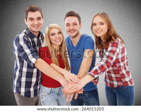 Group of happy young people, isolated on white background - stock photo