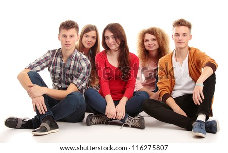 Group of happy young people isolated over white background - stock photo