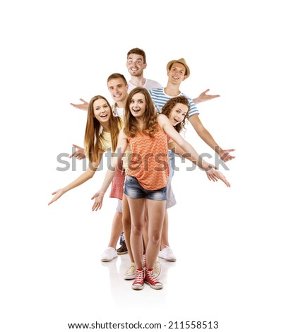 Group of happy young people posing in studio, isolated on white background. Best friends - stock photo