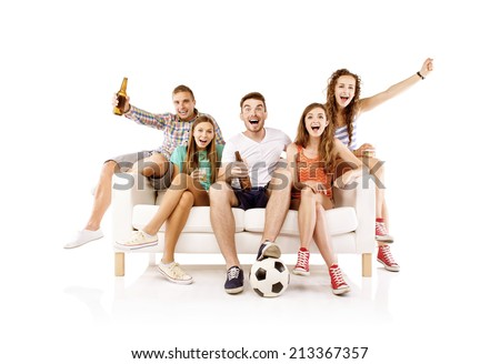 Group of happy young people sitting on sofa and holding soccer ball and bottled drinks, isolated on white background. Best friends - stock photo