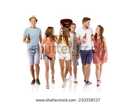 Group of happy young people walking, taking guitar and drinks with them, isolated on white background. Best friends - stock photo