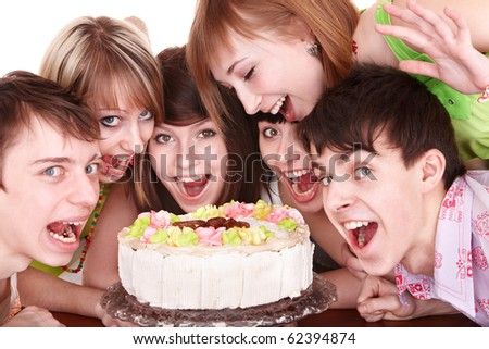 Group of happy young people with cake. Isolated. - stock photo