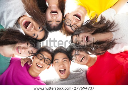 Group of happy  young student  with arms around each others shoulders - stock photo