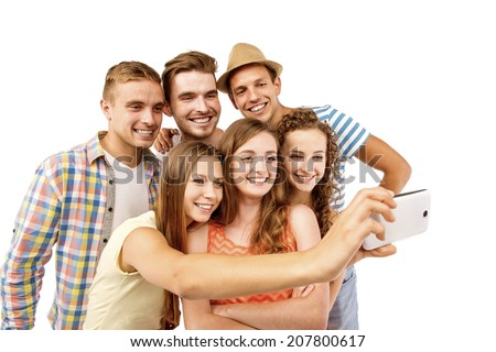 Group of happy young teenager students taking selfie photo isolated on white background - stock photo