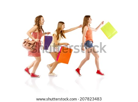 Group of happy young teenager students women standing and smiling with shopping bags isolated on white background. - stock photo