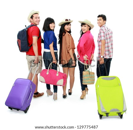 group of happy young tourist going on vacation bring suitcase viewed from behind - stock photo