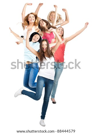 Group of happy young women in motion, jumping in air and laughing. Isolated on white background - stock photo