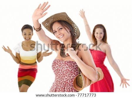 Group of happy young women waving hands in summer dresses.? - stock photo