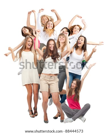 Group of happy young women with raised arms laughing. Isolated on white background - stock photo