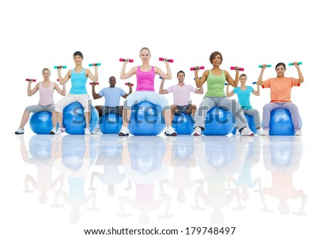 Group of Healthy People Exercising in Gym - stock photo