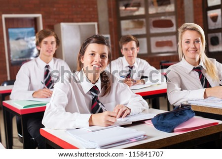 group of high school students in classroom - stock photo