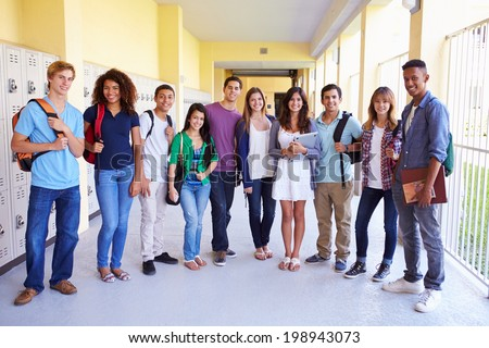 Group Of High School Students Standing In Corridor - stock photo