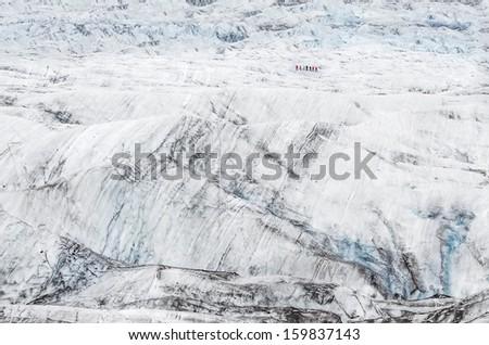Group of hikers ice climbing and trekking on Vatnajokull glacier, Iceland - stock photo