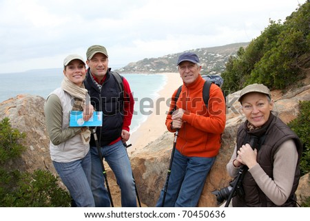 Group of hikers standing in natural trail - stock photo