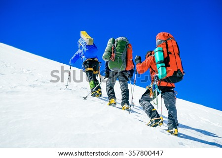 Group of hikers trekking in the winter mountains. Sport and active life - stock photo