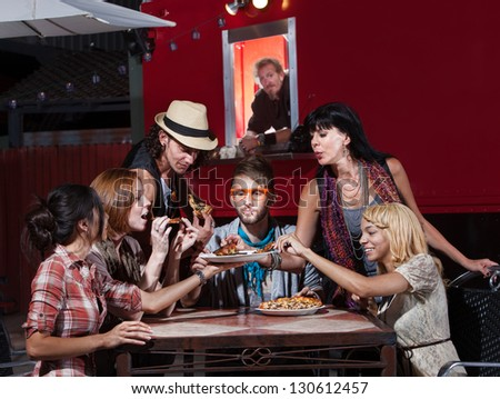 Group of Hipsters eating pizza at a mobile cafe - stock photo