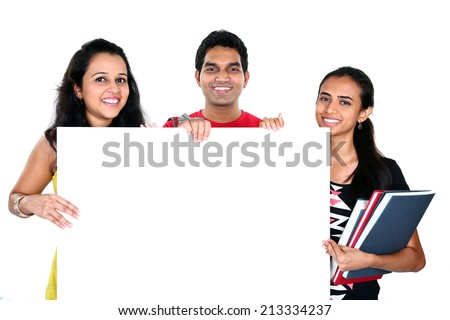 Group of Indian friends displaying white placard for your text isolated on white background - stock photo