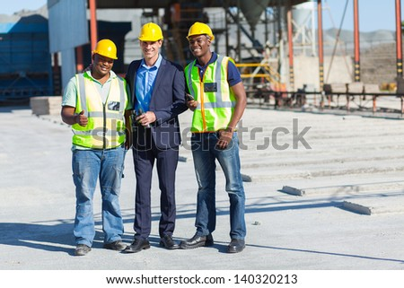 group of industrial manager and workers on site - stock photo