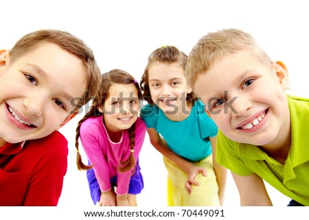 Group of joyful children peeping into camera - stock photo