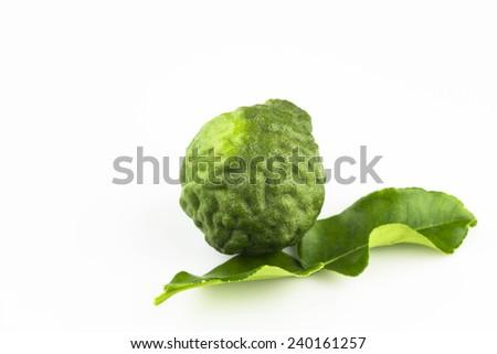 Group of kaffir Lime or Bergamot fruit on white background - stock photo
