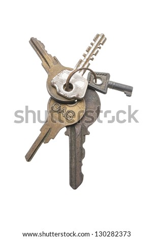 Group of keys on a key ring isolated against white background. - stock photo