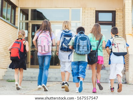 Group of kids going to school together. - stock photo