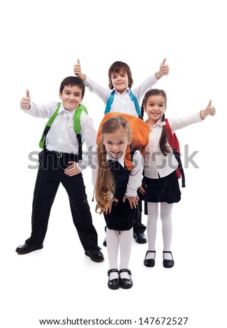 Group of kids happy about going back to school - isolated - stock photo